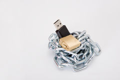 Security information. Pendrive, chain and lock on the white background Stock Image