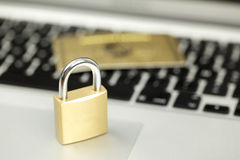 Security on internet, keyboard  lock and credit card Royalty Free Stock Photo