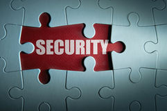 Security. Jigsaw puzzle with missing pieces revealing the word security Royalty Free Stock Images