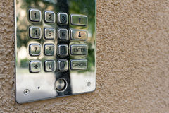 Security keypad on the wall. Entrance secured by an electronic keypad lock on a wall Royalty Free Stock Photography