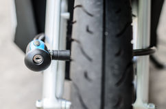 Security lock blocking the motorcycle front wheel Stock Images
