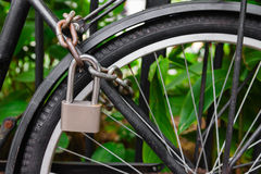 Security lock and chain blocking the bicycle wheel Royalty Free Stock Photos