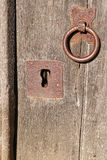 Security. Lock and door handle on a side door of the anglo-saxon christian church of All Saints at Brixworth, Northamptonshire (formerly the saxon kingdom of Royalty Free Stock Photos