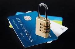 Security lock on multiple blank credit cards Stock Photo
