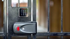 Free Security Lock On Black Iron Gate With A Touch Panel For Access Code Key. Stock Images - 185917954