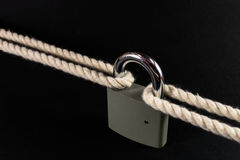 Security Lock Securing Rope Together Royalty Free Stock Photography