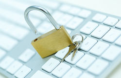Security lock on white computer keyboard Stock Images
