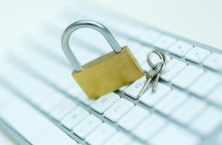 Security lock on white computer keyboard Stock Photo