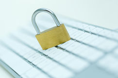 Security lock on white computer keyboard Stock Image
