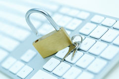 Security lock on white computer keyboard Royalty Free Stock Images