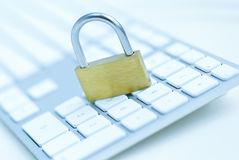 Security lock on white computer keyboard Royalty Free Stock Image