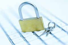 Security lock on white computer keyboard Stock Photography