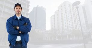 Security man in cityscape. Digital composite of Security man in cityscape Royalty Free Stock Photography