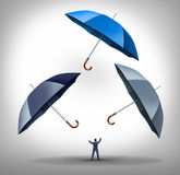 Security Manager. Business concept as a businessman juggling three umbrellas as a success metaphor for managing risk and protecting financial investment through Stock Images