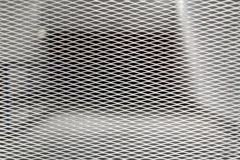Security mesh grid in front of a garage half transparent Royalty Free Stock Photos