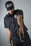 Security officer. In uniform pointing with a flashlight Royalty Free Stock Photo