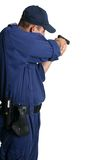 Security Officer aiming a gun. A security officer stands and aims his weapon while on duty or weapons training Royalty Free Stock Photos