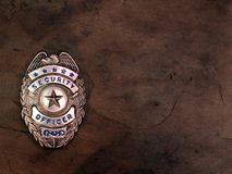Security Officer Badge. A police badge/shield on a slate background Royalty Free Stock Photo