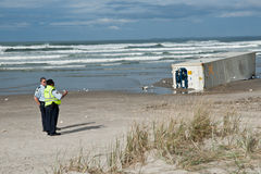 Security officer on beach to after Rena d Royalty Free Stock Photo