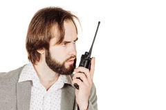 Security officer communicating through his walkie talkie.  Royalty Free Stock Image