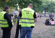 Security officers during the Carnival of Cultures 2018 in Berlin. Berlin, Germany - May 19, 2018: Security officers at work during the Carnival of Cultures stock image