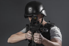 Security, paintball sport player wearing protective helmet aimin Stock Image