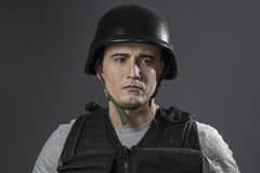 Security, paintball sport player wearing protective helmet aimin Royalty Free Stock Photos