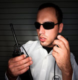 Security Patrol. Officer talking into a mobile radio Royalty Free Stock Images