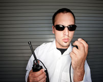 Security Patrol. Office holding radio with handset Royalty Free Stock Photos