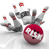 Security Pins Risk Bowling Ball Danger Risking Safety. The word Risk on a red bowling ball striking a series of pins marked Security illustrate safety Stock Images