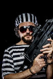 Security.Prison riot concept. Man holding a machine gun, prisone Royalty Free Stock Image