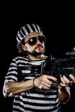 Security.Prison riot concept. Man holding a machine gun, prisone Stock Image