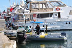 Security  in rubber boat and yachts at film festival in Cannes, France Stock Image