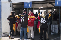 Security Screening Safety Check at Superbowl XLV. NFL Football fans are screened and searched at a security safety check before entering into the stadium area at royalty free stock images