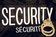 Security and Securite Vest with Handcuffs Stock Image