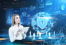 Security shield, polygons and an orb, blonde girl Royalty Free Stock Photos