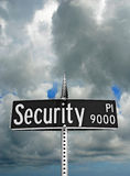 Security Sign. Under very ominous clouds Stock Photo