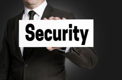 Security sign is held by businessman Royalty Free Stock Photos