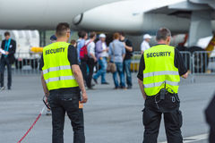 Security staff at the airfield. Royalty Free Stock Images
