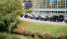 Security staff and limousine cars for diplomats during President Stock Photography
