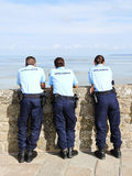 security staff watch tourists at tidal bay Mont Sa Stock Photo