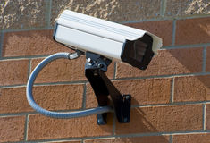 Security surveillance camera. On the side of an industrial building Stock Images