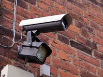 Security surveillance camera on a building corner Stock Photos