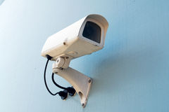 Security surveillance camera on a wall Royalty Free Stock Image