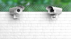 Security surveillance camera on white brick wall Stock Photography