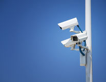 Security surveillance cameras. Security cctv cameras in front of blue sky Royalty Free Stock Images