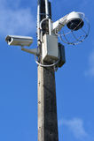 Security surveillance cameras. Two security surveillance cameras on a high pole at the park.concept photo of security Stock Photo