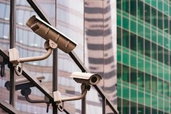 Security surveillance system at the entrance to a modern office building. Two cameras of video surveillance. Stock Photo