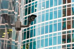 Security surveillance system at the entrance to a modern office building. Two cameras of video surveillance. Royalty Free Stock Photo