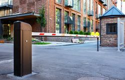 Automatic barrier and security system. Security system for building access - barrier gate stop. Automatic Rising Arm Or Drop Barrier. Intelligent Straight Pole Royalty Free Stock Photos